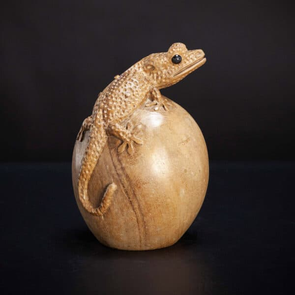 Carved Gecko Perched on Egg